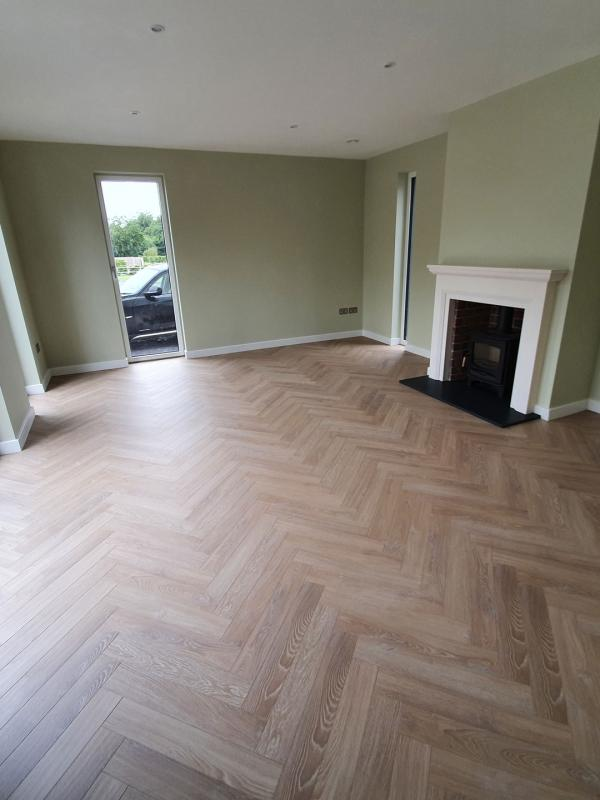 12mm Herringbone Laminate recently installed to living room