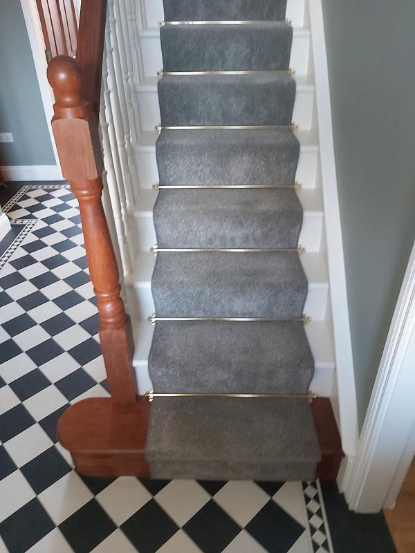 Amtico Design Floor to hallway, carpet with stair rods on stairs