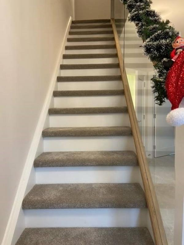Recent installation carpet to stair flats only