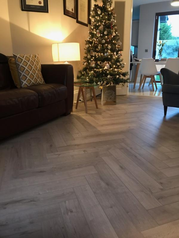 Recent installation Robust Grey Herringbone Laminate to living room